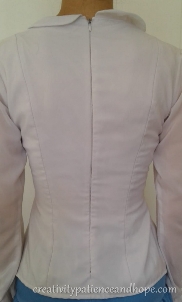 back view of fitted blouse with invisible zipper