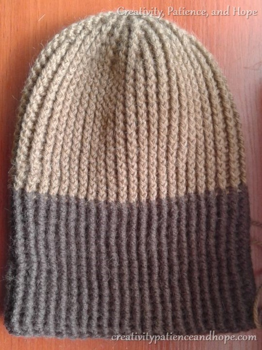 brown ribbed crochet hat with finished dark brown trim