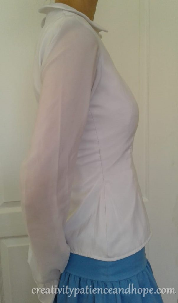 side view of fitted blouse with long sleeves