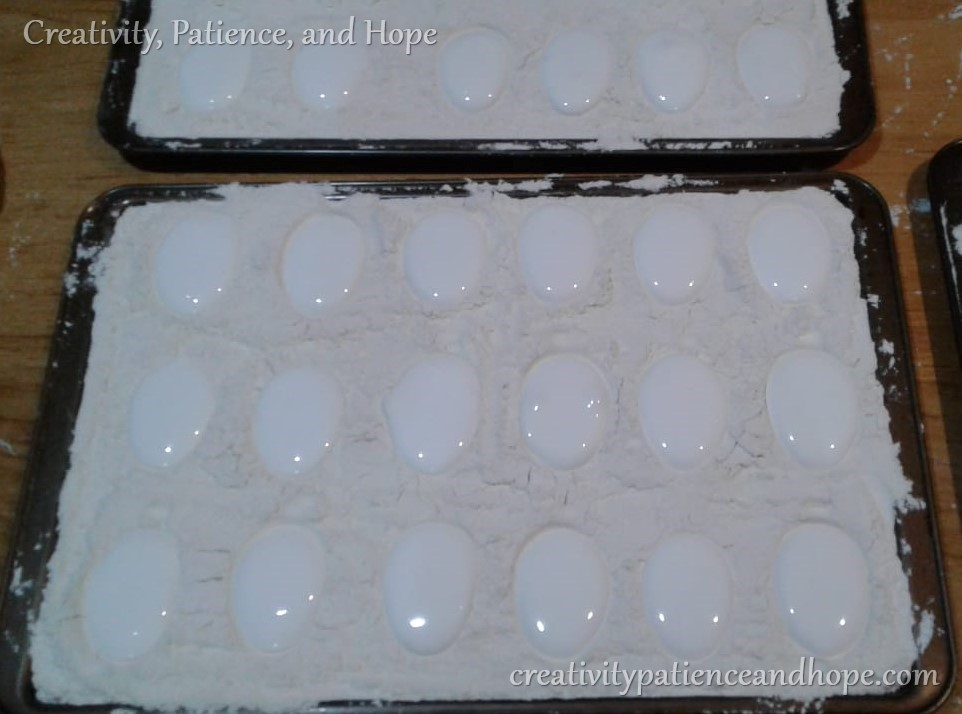 marshmallow eggs in flour molds in a pan