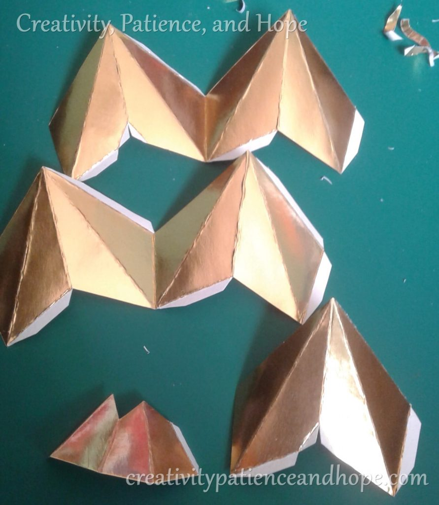 star template pieces with gold layer removed from gluing tabs