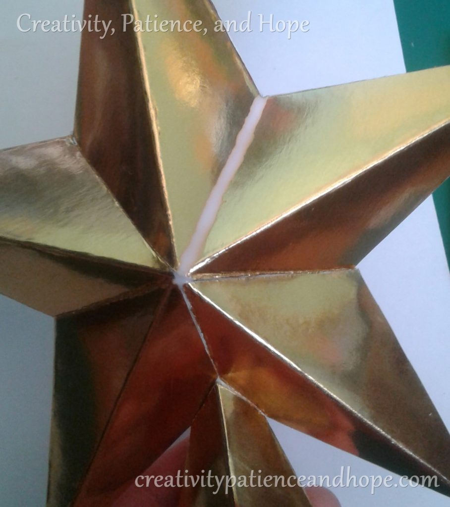gold star with line of glue for glitter