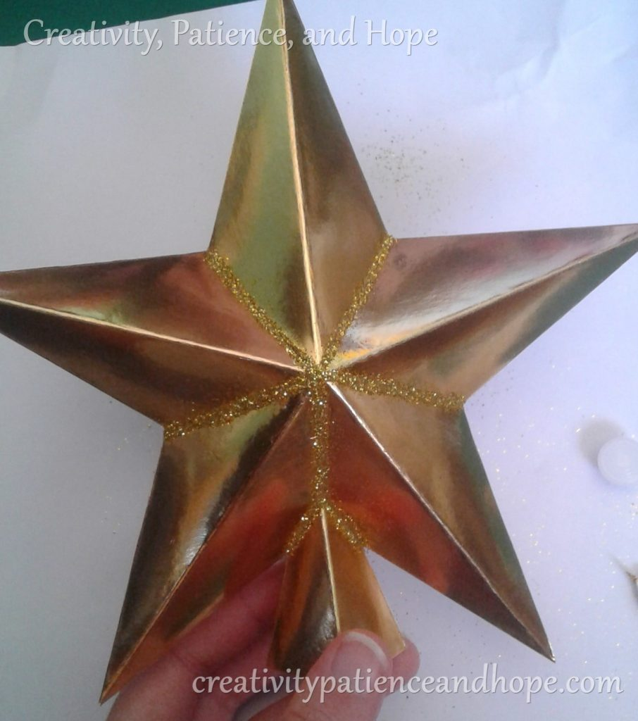 gold star with glitter on all inner edges
