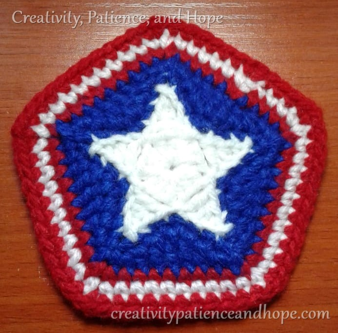 red white and blue coaster with star in center