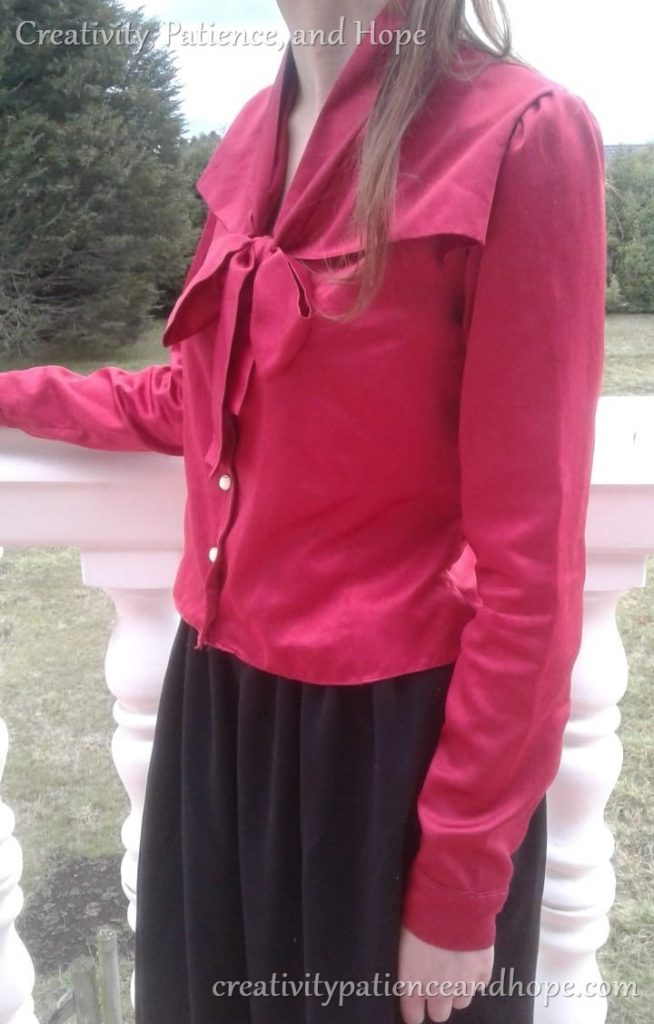 red long-sleeved blouse with bow collar